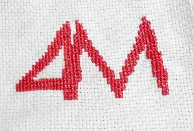 4M Designers Brand Identity Cross Stitched